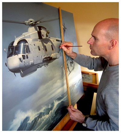 Neil Hipkiss at easel working on commission for Lockheed Martin